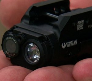 The 3.2-ounce, 3-inch long camera sits in front of the trigger and activates video and audio as soon as an officer pulls the gun from the holster. (Screenshot/Star Tribune)