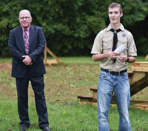 Anna Boy Scout Troop 301 member Merrick Fox, right, 16, of Sidney, son of Shawn and Claudia Fox, talks about his Eagle Scout project during its dedication behind the Shelby County Sheriff's Office Wednesday, Sept. 26. Fox built an obstacle course for K-9 units. (Photo/Luke Gronneberg, Sidney Daily News)