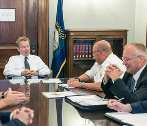Senator Rand Paul discusses permanent EMS Medicare reimbursement reform Thursday with Kentucky Ambulance Providers Association president Thomas Adams and Kentucky Board of Emergency Medical Services executive director Michael Poynter. (Photo/John Hultgren)