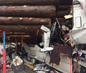 A field amputation was necessary to remove the drive of a semi after a collision with a log hauler on a remote stretch of I-90 in north Idaho. (All photos courtesy of Kootenai Fire and Rescue)