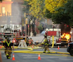 A firefighter was killed and at least a dozen other people were injured when a natural gas explosion leveled at least two buildings. (Photo/AP)