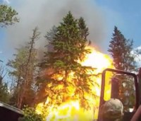 Video: Firefighter narrowly escapes dramatic explosion