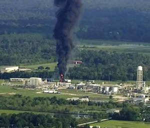 Nearly 20 residents say test results have detected toxic substances in soil, water and ash samples taken miles from the chemical plant explosion. (Photo/AP)