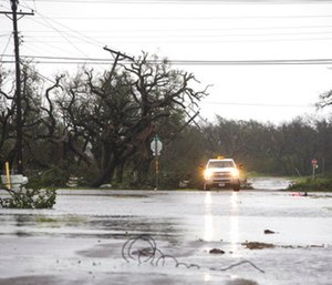 A vehicle drives through flooded roads after Hurricane Harvey ripped through Rockport, Texas, on Saturday, Aug. 26, 2017. (Photo/AP)