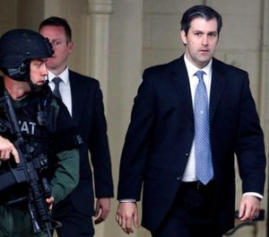 In this Monday, Dec. 5, 2016, file photo, former South Carolina officer, Michael Slager, right, walks from the Charleston County Courthouse under the protection of the Charleston County Sheriff's Department after a mistrial was declared for his trial in Charleston, S.C. (AP Photo/Mic Smith, File)