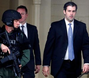 In this Monday, Dec. 5, 2016, file photo, former South Carolina police officer Michael Slager, right, walks from the Charleston County Courthouse under the protection of the Charleston County Sheriff's Department after a mistrial was declared for his trial in Charleston, S.C. (AP Photo/Mic Smith, File)