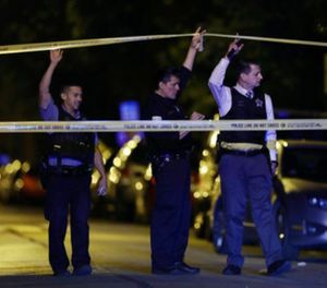 In this Sept. 2, 2017, file photo, police lift crime scene tape after two people were shot and transported to Stroger Hospital in Chicago. (John J. Kim/Chicago Tribune via AP, File)