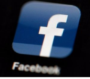 This photo shows the Facebook app displayed on an iPad. (AP Photo)