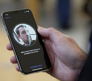 In this Friday, Nov. 3, 2017, file photo, an Apple employee demonstrates the facial recognition feature of the new iPhone X at the Apple Union Square store in San Francisco. (AP Photo/Eric Risberg, File)