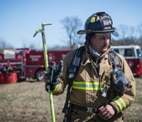 What should all firefighters carry with them?