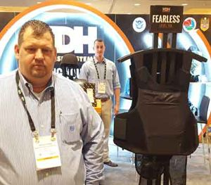 Wayne Grimes (left) and Michael Silva display the new KDH Fearless Concealment Carrier at SHOT Show 2016. (PoliceOne Image)