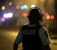 Police deploy tear gas to impose Mo. curfew