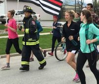 Firefighter breaks world record by running 100 miles in full gear