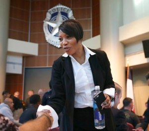 In this Sept. 7, 2017 file photo, new Dallas Police Chief U. Reneé Hall shakes hands with potential police recruits during an applicant processing event at police headquarters in Dallas. Citizens in recent months have complained to Hall of blocked attempts at filing complaints against police officers and low confidence in the investigations. (AP Photo/LM Otero, File)