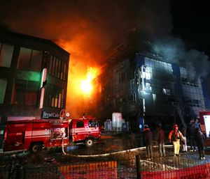 Firefighters try to extinguish a fire at an eight-floor building in Jecheon, South Korea. (Kim Hyung-woo/Yonhap via AP)