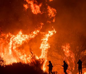Motorists on Highway 101 watch flames from the Thomas fire leap above the roadway north of Ventura, Calif. (AP Photo/Noah Berger)