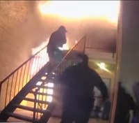 Video: Texas boy jumps from burning apartment to officers