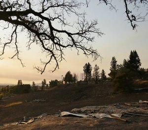 Charred ground and only a few pieces are the remains of the historic Fountaingrove Round Barn Wednesday, Oct. 11, 2017, in Santa Rosa, Calif. (AP Photo/Eric Risberg)