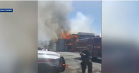 Officer nearby fire scene pulls injured firefighter to safety