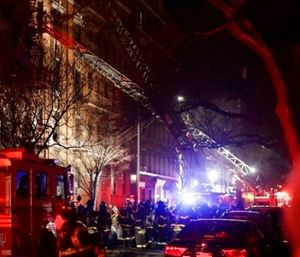 About 170 firefighters fought a fatal New York City fire and rescued fleeing tenants. (Photo/AP)