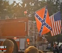 Firefighter fired for flying Confederate flag at parade