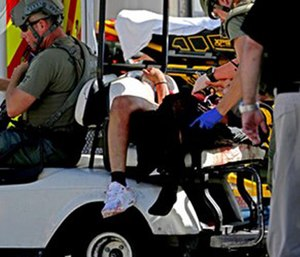 Medical personnel tend to a victim following a shooting at Marjory Stoneman Douglas High School in Parkland, Fla. (John McCall/South Florida Sun-Sentinel via AP)