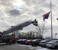 Fire dept. helps officer fix upside-down American flag at local business