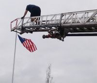 Firefighters help save U.S. flag in honor of late father, soldier