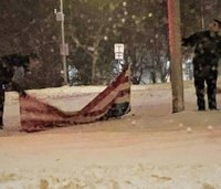 Photo: EMS providers pick up fallen American flag in snowstorm