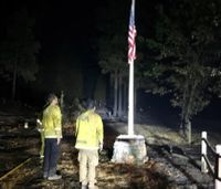 Firefighters use flag found intact after wildfire to honor fallen comrades