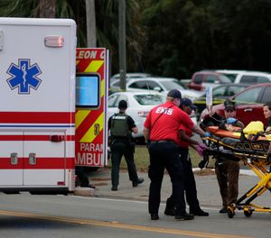 A person is transported from scene of a shooting, Friday, Nov. 2, 2018, in Tallahassee, Fla. (Tori Schneider/Tallahassee Democrat via AP)