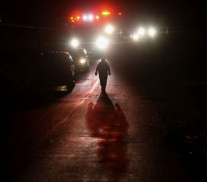 In this Friday, Sept. 7, 2018 photo, crews search for a Greene County Sheriff's deputy believed to have been swept away by high water in northern Greene County in Mo. (Andrew Jansen/The Springfield News-Leader via AP)