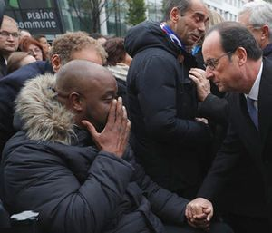 French President Francois Hollande speaks with a victim after unveiling a commemorative plaque outside the Stade de France stadium, in Saint-Denis, near Paris, France. (Philippe Wojazer/Pool Photo via AP)