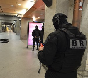 A member of the Research and Intervention Brigades (BRI) controls a drone during a terror attack exercise at the Gare Montparnasse railway station in Paris, Wednesday, April 20, 2016. (Miguel Medina, Pool Photo via AP)