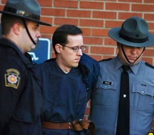 In this Jan. 5, 2015 file photo, Eric Frein is led away by Pennsylvania State Police Troopers at the Pike County Courthouse after his preliminary hearing in Milford, Pa. (Butch Comegys/The Times & Tribune via AP, File)