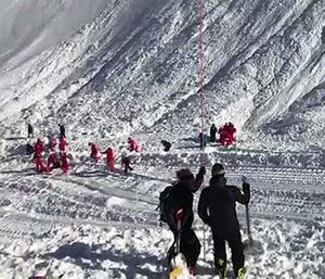 In this image taken from video, rescue personnel work at the site of an avalanche at Lavachet Wall in Tignes, France, Monday Feb. 13, 2017. (AP Photo)