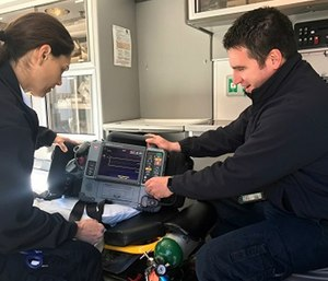 Ada County Paramedics Field Training Officer, Justin Raney, goes over equipment with EMT B MK Welch. (Photo/Ada County Paramedics )