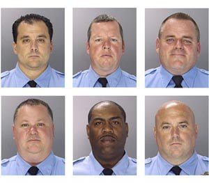 This undated photo combination provided by the Philadelphia Police Department shows from top left to right, Philadelphia Police officers Thomas Liciardello, Brian Reynolds, Michael Spicer, and from bottom left to right, Perry Betts, Linwood Norman and John Speiser. (AP Image)