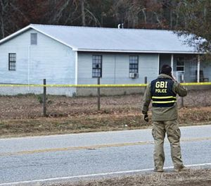 Georgia Bureau of Investigation Special Agent in Charge J.T. Ricketson works at a scene of a shooting involving multiple officers while serving a search warrant at a home in Crawford County, Ga., Monday, Dec. 12, 2016. (Woody Marshall/The Macon Telegraph via AP)