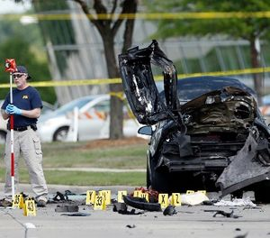 In this May 4, 2015 file photo, FBI crime scene investigators document evidence outside the Curtis Culwell Center in Garland, Texas. (AP Photo/Brandon Wade, File)