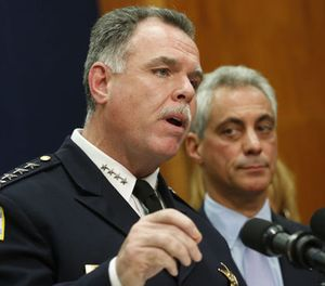 In this Oct. 15, 2013 file photo Chicago Police Superintendent Garry McCarthy, left, speaks at a news conference accompanied by Mayor Rahm Emanuel in Chicago. (AP Photo/M. Spencer Green, File)