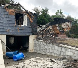 The house owned by Lawrence Police Officer Ivan Soto sits nearly burned to the ground on Jefferson Street, in Lawrence, Mass., Friday, Sept. 14, 2018. (AP Photo/Bob Salsberg)