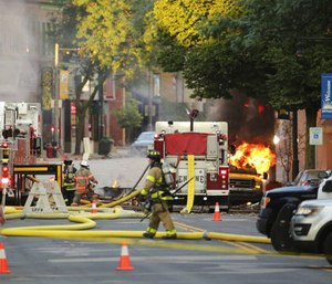 State utility regulators have opened a formal investigation into last summer's fatal Sun Prairie natural gas explosion that killed a firefighter and leveled several buildings in the city's downtown. (Photo/AP)