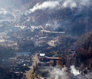 Burned structures are seen from aboard a National Guard helicopter near Gatlinburg, Tenn., Tuesday, Nov. 29, 2016. (AP Photo/Erik Schelzig)