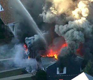 """A series of gas explosions an official described as """"Armageddon"""" killed a teenager, injured at least 10 other people and ignited fires in at least 39 homes. (Photo/AP)"""