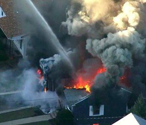 """A series of gas explosions an official described as """"Armageddon"""" killed a teenager, injured at least 10 other people and ignited fires in at least 39 homes Sept. 13. (Photo/AP)"""