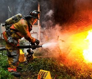 Army Pvt. 1st Class Lucas Ternell puts out a small debris fire in a yard in Salisbury, Md. (Photo/Wikimedia Commons)