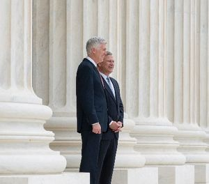 In this photo provided by the Supreme Court new Supreme Court Justice Neil Gorsuch, left, stands with Chief Justice John Roberts outside the court in Washington, Thursday, June 15, 2017, following Gorsuch formal investiture ceremony of Associate Justice. (Fred Schilling/Supreme Court via AP)