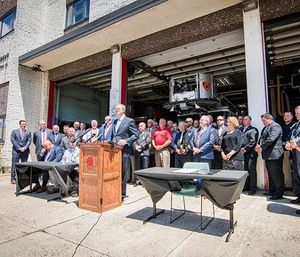 Gov. Charlie Baker signed a bill into law that covers medical treatment and time missed due to illness for all firefighters diagnosed with cancer. (Photo/Gov. Charlie Baker's Office)