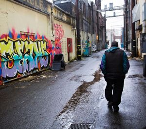 A person walks through an alley decorated with graffiti messages in downtown Aberdeen, Wash., Thursday, June 15, 2017. (AP Photo/David Goldman)